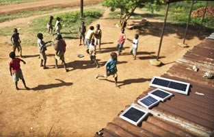Kids playing in yard with solar panels on roof