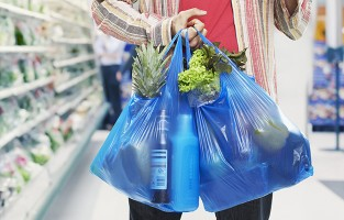 man holding shopping in plastic bags