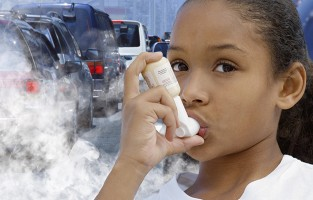 Girl with asthma using an inhaler against a background of car exhaust fumes