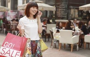 Woman shopping talking on phone